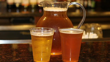 pitcher with two beers
